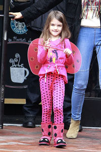 Suri Cruise in a Ladybug Costume